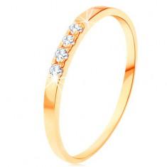 Zlatý prsteň 585 - línia štyroch čírych briliantov, tenké lesklé ramená
