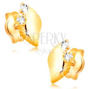 Diamantové náušnice zo žltého 14K zlata - dva číre brilianty, lesklý lístoček