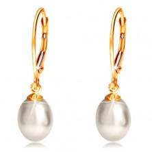 Náušnice zo žltého 14K zlata s visiacou oválnou perlou bielej farby