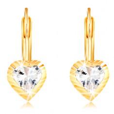 Šperky eshop - Náušnice zo žltého 14K zlata - srdiečko so zárezmi a zirkónom  uprostred GG209 3a14f29eff7