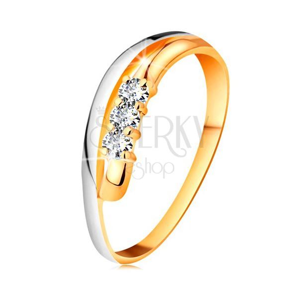 Briliantový prsteň v 18K zlate, zvlnené dvojfarebné línie ramien, tri číre diamanty