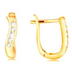 Šperky eshop - Zlaté náušnice 585 - lesklá zvislá vlnka zo žltého zlata, pás čírych zirkónov GG210.18