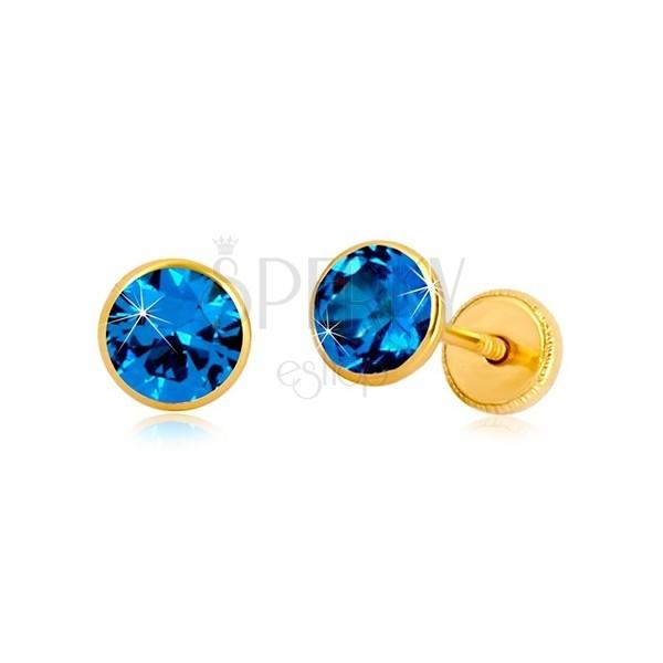 Náušnice zo žltého 14K zlata - modrý zirkón v objímke, puzetky so závitom, 5 mm