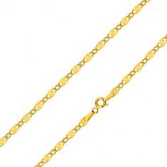 Šperky eshop - Retiazka v žltom zlate 585 - oválne očká, podlhovasté články s lúčovitými zárezmi, 550 mm GG99.40