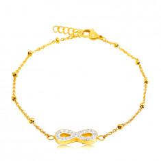 Oceľový náramok v zlatej farbe - jemná retiazka s korálkami, symbol nekonečno s kryštálikmi