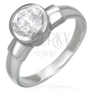 Oceľový snubný prsteň s veľkým zirkónovým očkom v kovovej objímke