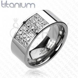 Prsteň z titánu s obdĺžnikovým výrezom vykladaným zirkónmi