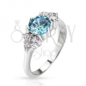 Prsteň z ocele - vystúpený modrý zirkón v strede a číre kamene