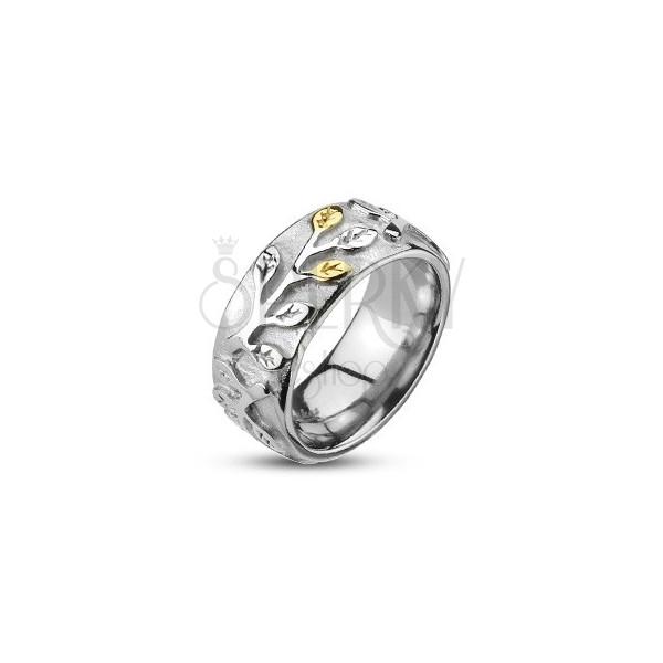 Oceľový prsteň s lístkami zlato-striebornej farby a patinou